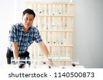 asian handsome man is taking a... | Shutterstock . vector #1140500873