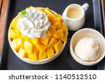 shaved ice dessert served with... | Shutterstock . vector #1140512510