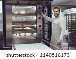 smiling baker in bakery... | Shutterstock . vector #1140516173