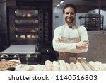 smiling baker in bakery... | Shutterstock . vector #1140516803