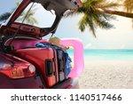 summer car on beach and palms  | Shutterstock . vector #1140517466