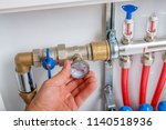 the plumber hand connects the... | Shutterstock . vector #1140518936