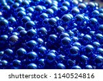 a lot of beads. brilliant blue... | Shutterstock . vector #1140524816