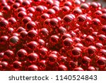 a lot of beads. brilliant red... | Shutterstock . vector #1140524843