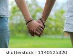 couples holding hands in... | Shutterstock . vector #1140525320