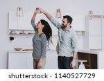 young happy couple dancing in... | Shutterstock . vector #1140527729
