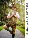 bavarian man standing outdoors... | Shutterstock . vector #1140529520