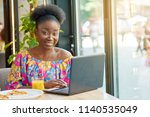 smiling woman working in cafe... | Shutterstock . vector #1140535049