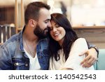 romantic couple dating in cafe   Shutterstock . vector #1140542543