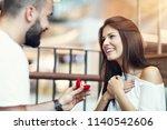 handsome man proposing to...   Shutterstock . vector #1140542606