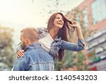 portrait of happy couple with...   Shutterstock . vector #1140543203
