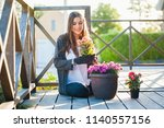 beautiful young woman gardening ... | Shutterstock . vector #1140557156