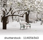 Bench In The Park In The Snow...