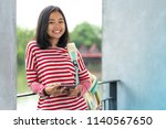 asian student girl with a... | Shutterstock . vector #1140567650