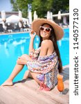 beautiful young woman with... | Shutterstock . vector #1140577130