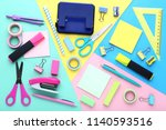 school supplies on colorful... | Shutterstock . vector #1140593516