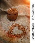 grains of buckwheat at sunset ... | Shutterstock . vector #1140603209