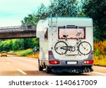 rv camper car with bicycle on...