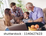 portrait of a three generation... | Shutterstock . vector #1140627623