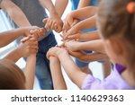little children holding their... | Shutterstock . vector #1140629363
