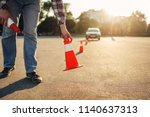instructor sets the cone ... | Shutterstock . vector #1140637313