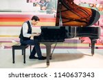 male pianist practicing... | Shutterstock . vector #1140637343