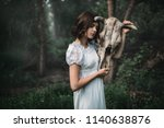 victim with skull of the animal ... | Shutterstock . vector #1140638876