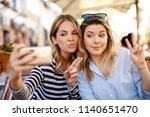 two women friends taking a... | Shutterstock . vector #1140651470