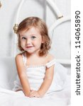 sweet curly girl sit in bed | Shutterstock . vector #114065890