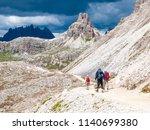 mountain hikers with trekking... | Shutterstock . vector #1140699380