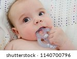little baby boy eats  teething... | Shutterstock . vector #1140700796