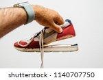 man holding against white... | Shutterstock . vector #1140707750