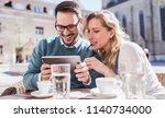 dating. young couple sitting in ... | Shutterstock . vector #1140734000