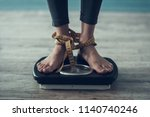 close up. young woman standing... | Shutterstock . vector #1140740246