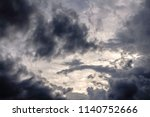irregular clouds in darkening... | Shutterstock . vector #1140752666