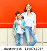 fashion smiling mother with son ... | Shutterstock . vector #1140761069