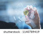 bitcoin in hand of business man ... | Shutterstock . vector #1140789419