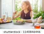 young asian woman happy eating... | Shutterstock . vector #1140846446