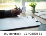 executives are viewing a list... | Shutterstock . vector #1140850586