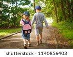 little friends children hold... | Shutterstock . vector #1140856403