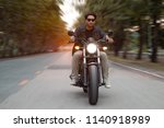 handsome asian man riding red... | Shutterstock . vector #1140918989