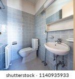 vintage bathroom with blue... | Shutterstock . vector #1140935933