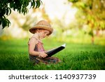 little girl with a book in the... | Shutterstock . vector #1140937739