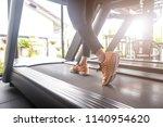 image of female foot running on ... | Shutterstock . vector #1140954620