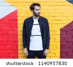 youth men's fashion. a young... | Shutterstock . vector #1140957830