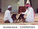 two religious muslim man...   Shutterstock . vector #1140965363
