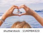 beautiful woman traveler makes... | Shutterstock . vector #1140984323
