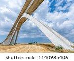 railroad track with huge bridge ... | Shutterstock . vector #1140985406