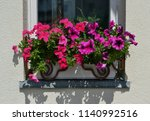 window with flower pots and... | Shutterstock . vector #1140992516