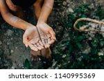 hands poor child or beggar... | Shutterstock . vector #1140995369